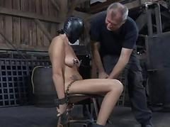 Gagged and tied up girl gets her clits pleasured