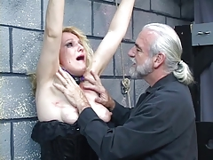Old blonde milf gets strapped involving for some scatter