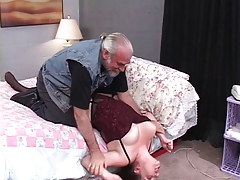 Sexy, thick brunette is bound and fucked unaffected by the bed by an older dude