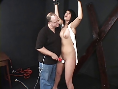 Dark?haired hottie, bound and has her pussy pleasured overwrought her master