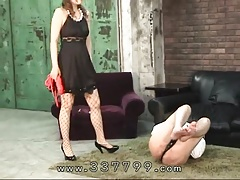 Japanese femdom Mayumi is dripping wax on the slaves penis.