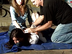Women hogtied with the addition of gagged in Garage