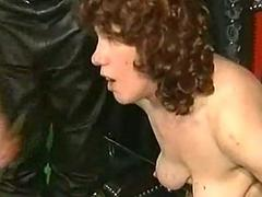 Crying slave with her body covered in candle wax is spanked