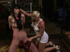 Well-dressed mistress playing with her sexslave