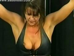 Beautiful slave with big breast and her hands tied got spanked