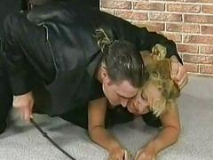 Blond slave with big tits is spanked and got her bosom tied