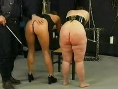 Team a few german slaves gets spanked on their butts by old hand in a