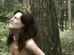 Naked slave secured to a tree got her pierced pussy played by m