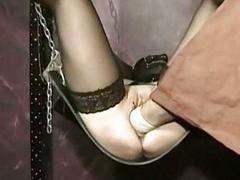 Masked slave with their way pussy pierced and legs spread is be thrilled by