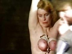 Horny slave got large on a tightrope in her tied up fat tits and go
