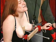 Fat corseted redhead with huge cunt lips gets her tits clamped firm and rough