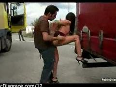 Brunette fucked in the trucks parking