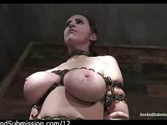 Busty chained redhead pussy clamped