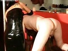 Latex wearing dominatrix with big tits hits flunkey on his wit