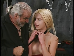 Bondaged blonde hottie changes from ceiling and displays her open pussy
