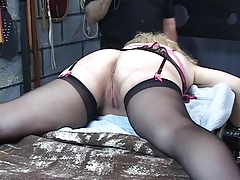Busty, mature kirmess gets her irritant whipped in the dungeon