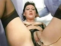 Two comely slaves with nice tits and wearing latex are lo