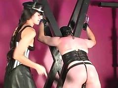 Submissive slave spanked with sculler