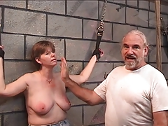 Slave gets leather cuffs above the brush wrists and master puts a whip above the brush bosom